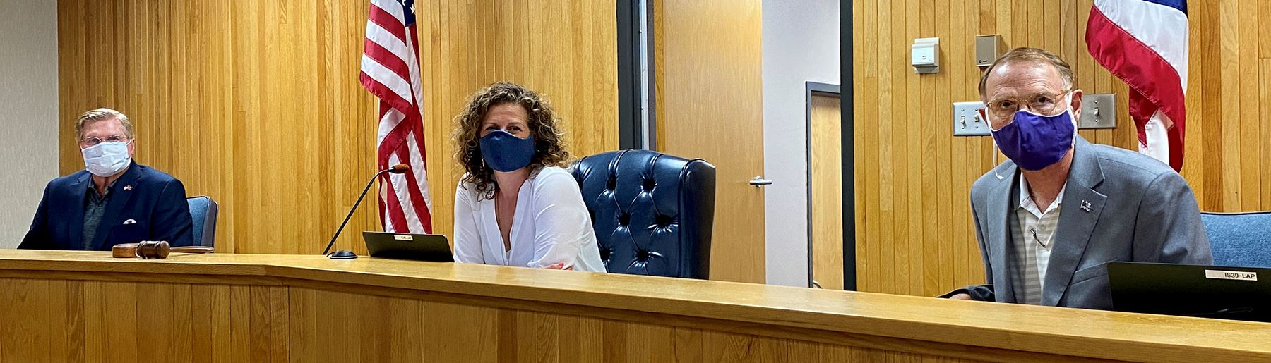 Clark County commissioners wear masks at a recent meeting.