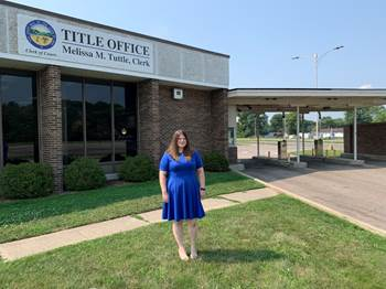 Clark County Clerk of Courts Meliss Tuttle stands outside the office's drive-thru in Springfield.